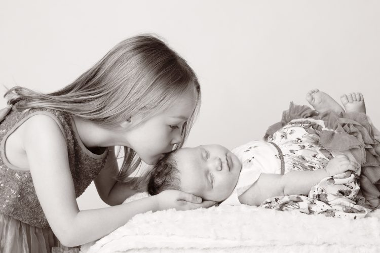 Girl kissing baby sisiter RJM-Photography